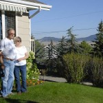 Kenny and Sharlene in front of their Helena, MT home.