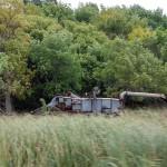 No buttes in Minnesota to enshrine this old threshing machine.